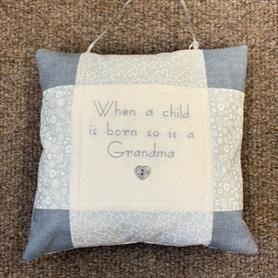 Embroidered Cushion - When a child is born....